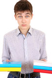 Serious Student with the Books. Anxious Student with the Books Isolated on the White Background Royalty Free Stock Photography