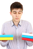 Serious Student with the Books. Isolated on the White Background Royalty Free Stock Images