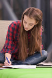 Serious student. Charming student preparing to the exams stock photo