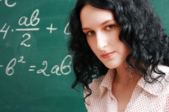 Serious student and formula Royalty Free Stock Photo