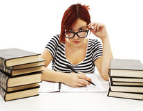 Serious student girl looking over the top of her glasses Stock Image
