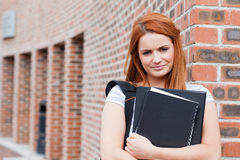 Serious student holding her binder Royalty Free Stock Images