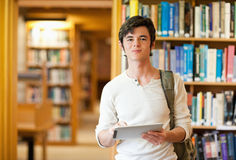 Serious student holding a tablet computer Stock Photography