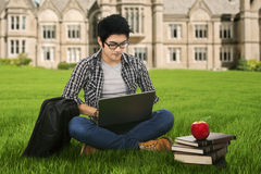 Serious student studying outdoor. Portrait of male high school student studying on the park Royalty Free Stock Photos