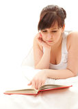 Serious student woman reading book Stock Images