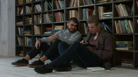 Hipster students studying in library at university stock video footage