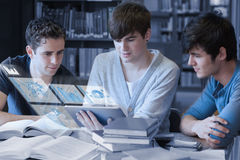 Serious students working on their digital tablet pc Royalty Free Stock Image
