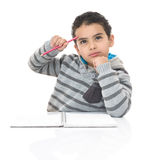 Serious Studying Boy Thinking for Answer Royalty Free Stock Images