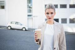 Serious stylish businesswoman holding coffee Royalty Free Stock Image