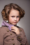 Serious stylish little girl with bow Royalty Free Stock Images
