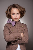 Serious stylish little girl looking at camera Stock Images