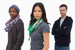 Serious stylish young people in a row Stock Photos