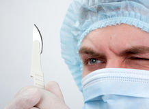 Serious surgeon with knife Royalty Free Stock Images