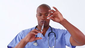 Serious surgeon preparing a syringe stock footage