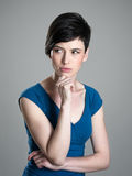 Serious suspicious or worried young short hair woman looking away Royalty Free Stock Photo