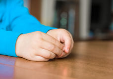 Serious talk. Hands of a little child, who is willing to negotiate with adults Stock Photography