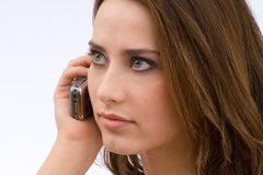 Serious talking. Young woman having a phone call Royalty Free Stock Image