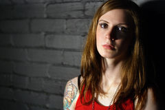 Serious tattoo girl Stock Images