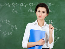 Serious teacher at the blackboard Stock Photo