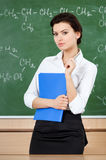Serious teacher at the blackboard Royalty Free Stock Image