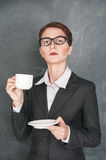 Serious teacher with cup of coffee Stock Photos