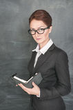 Serious teacher with organizer royalty free stock photography