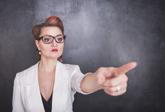 Serious teacher pointing out on chalkboard background. Serious teacher pointing out on chalkboard blackboard background stock photos