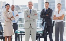 Serious team of business people posing together Royalty Free Stock Photography