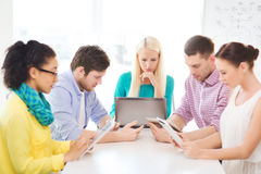 Serious team with table pc and laptop in office Stock Photos