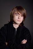Serious teen boy Stock Images