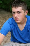 Serious teen boy. Handsome young teen boy in natural light Royalty Free Stock Photos
