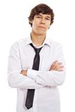 Serious teen with crossed arms. Confident young man in white shirt with loose tie and crossed arms on chest. Isolated on white background, mask included Stock Image