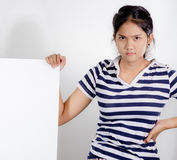 Serious teen girl. Closeup portrait  serious thai teen girl holding white board Royalty Free Stock Images