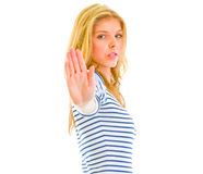 Serious teen girl showing stop gesture Royalty Free Stock Photo