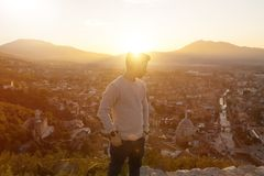 Serious teen looking sideways to the city of Prizren, Kosovo in Stock Image