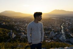 Serious teen looking sideways to the city of Prizren, Kosovo in Royalty Free Stock Images