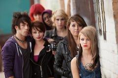 Serious Teen Punk Gang. Gang of young teen punks stare seriously towards the camera Stock Photos