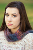 Serious Teen Staring. Single serious female teenager in sweater staring Royalty Free Stock Image