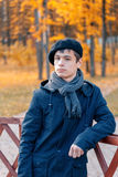 Serious teenage boy in the autumn sunny park Royalty Free Stock Images