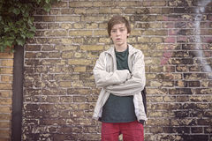 Serious teenage boy with crossed arms Royalty Free Stock Photo