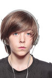 Serious teenage boy with headphones Stock Photography