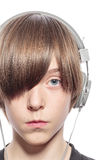 Serious teenage boy with headphones Stock Images