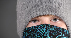 Serious Teenage Boy wearing hat and bandana royalty free stock photos