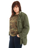 Serious teenage girl in military jacket Royalty Free Stock Photo