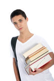 Serious teenaged boy with textbooks Stock Images