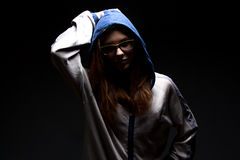 Serious teenager girl in shadow with hood. Serious teenager girl in shadow - photo portrait Stock Images