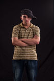 Serious teenager try to be cool standing with cap put on one Stock Photo