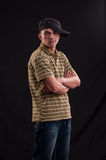 Serious teenager try to be cool standing with cap put on one Royalty Free Stock Photos