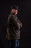 Serious teenager try to be cool standing with cap put on one Royalty Free Stock Images