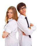 Serious teens in office dress stock images